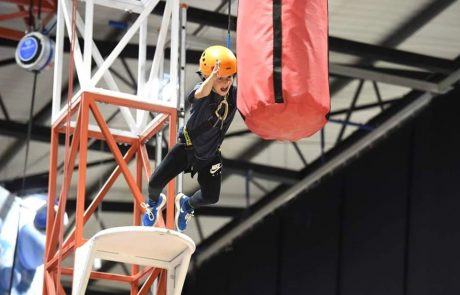 Boy leaping off a platform at Grip And Go at The Adrenaline centre in Rossendale Adrenaline Valley