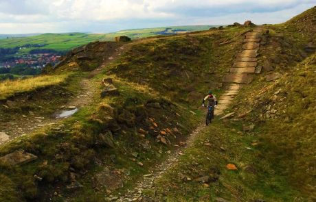 Image of child on a mounain bike coming down a dirt path for Lee Quarry Trial Centre page on Visit Rossendale website