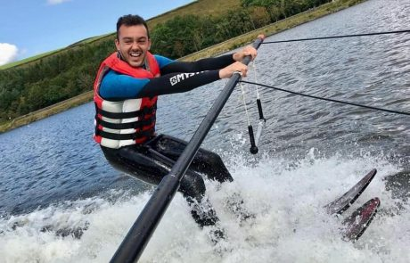 Man water skiing on a pole for Whitworth Water Ski Academy page on the Visit Rossendale Website